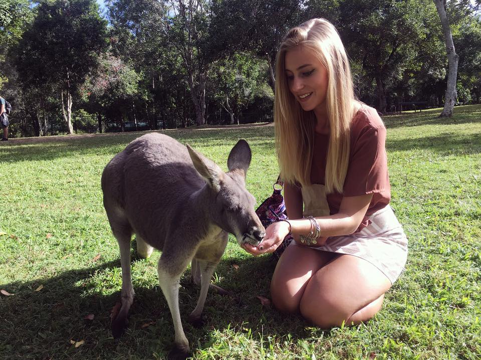 Mykayla with a kangaroo in Australia