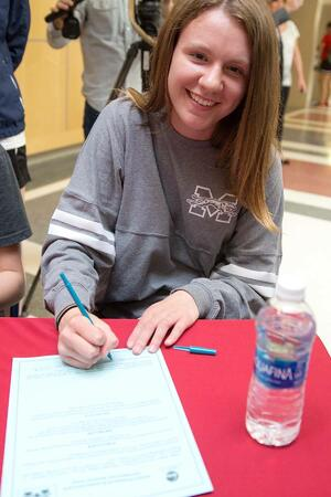 Pictured here is me at senior year signing to division three sports
