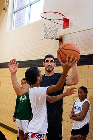 Enes Kanter plays basketball with kids at the Bethlehem YMCA