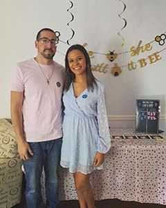 Dior Mariano and her husband at a baby reveal party.