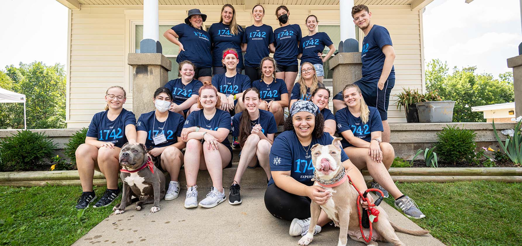Students who participated in the 1742 Experience in August of 2021 seated together on the steps outside the Humane Society of Lehigh County.