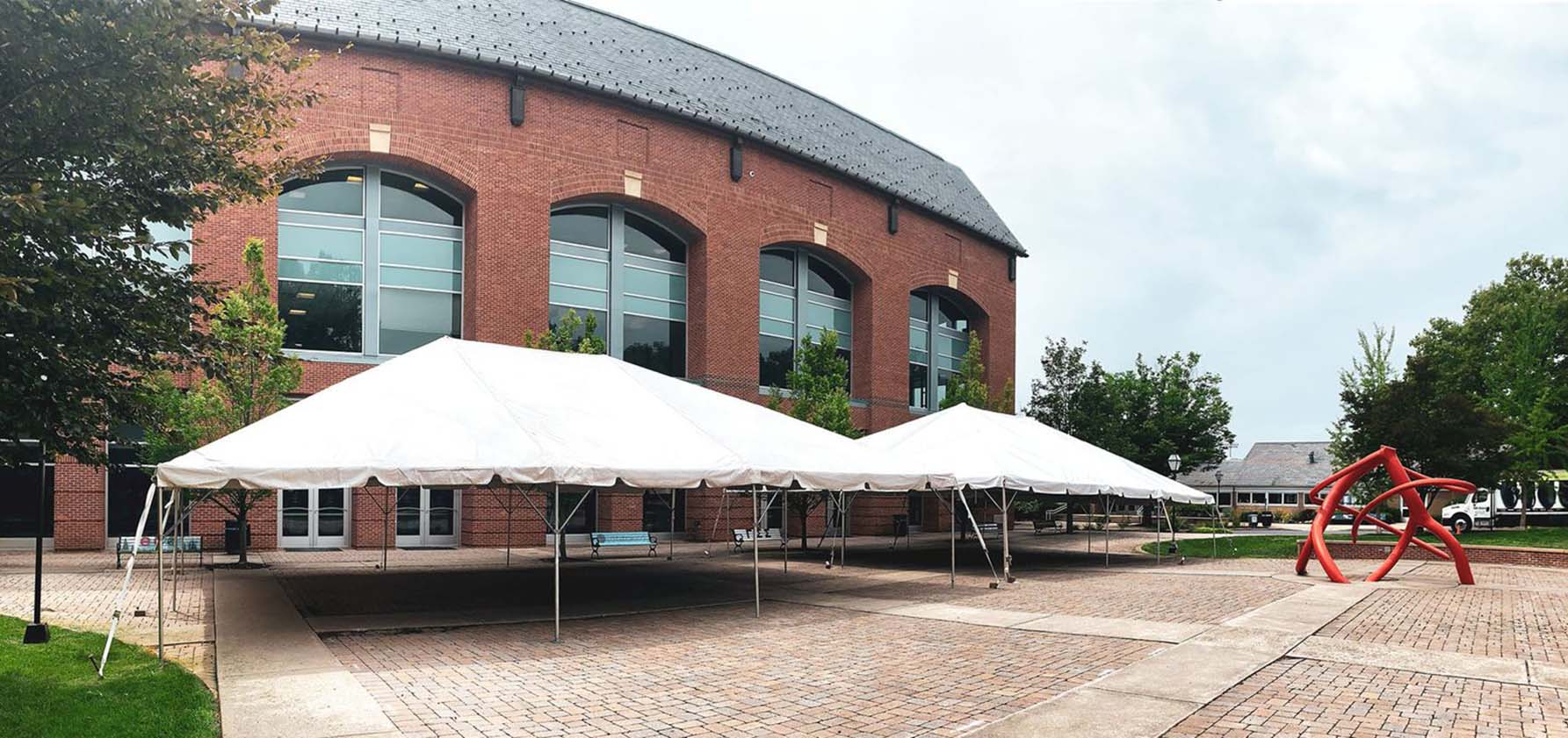 Tents for outdoor gatherings stand outside the Priscilla Payne Hurd Academic Center.