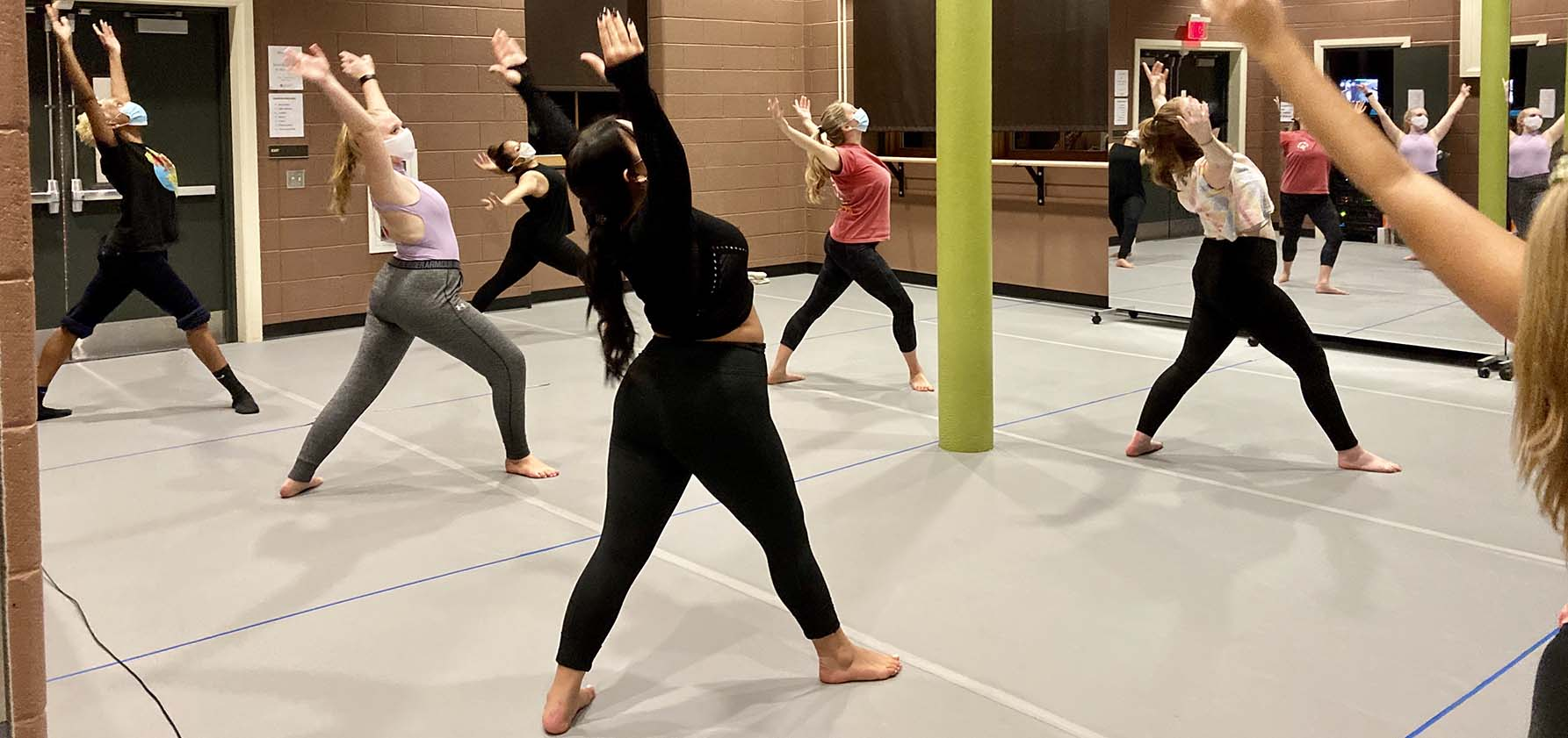 Members of the Moravian College Dance Company practice ballet in the new dance studio.