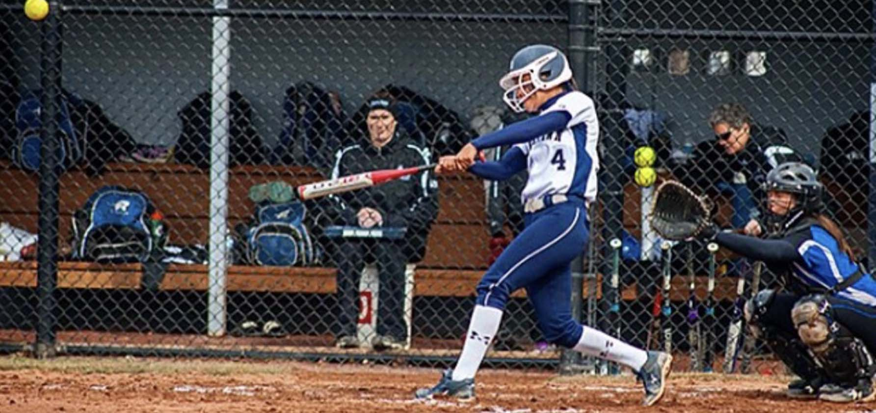 Dior Mariano '15 executes a hit in a softball game as a member of the Moravian Women's Softball Team.