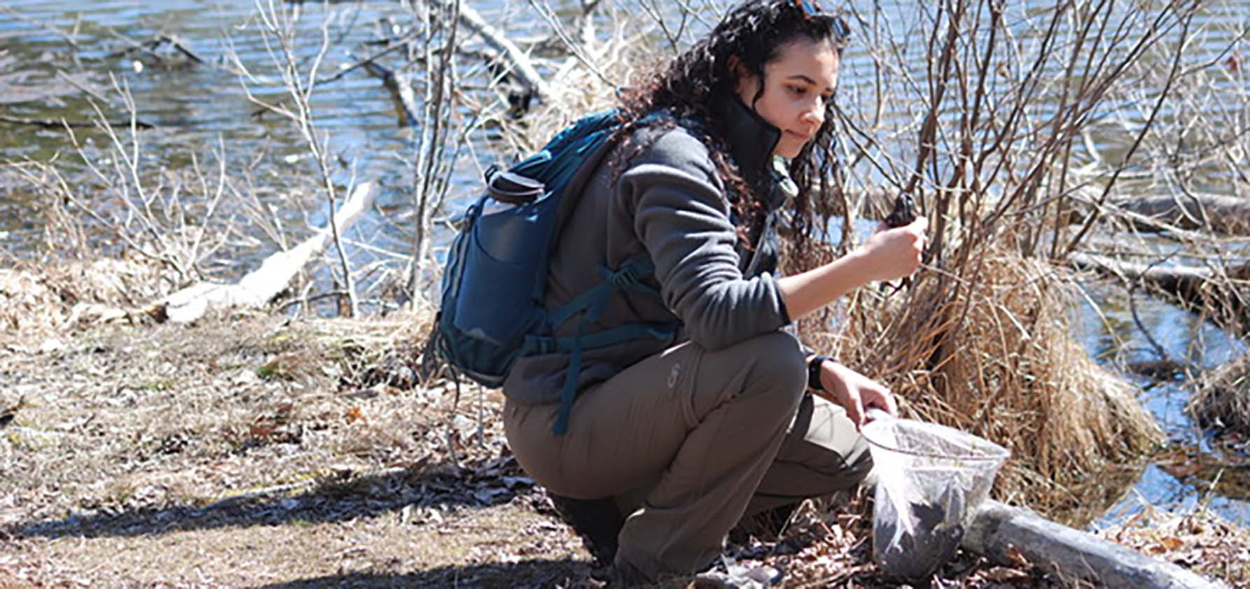 Melissa Morales '21 explores the animal life along a stream near her home in the Poconos.