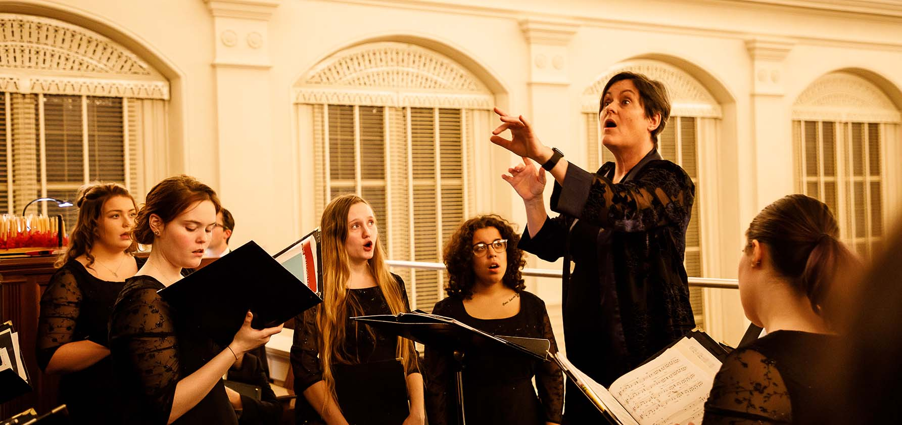 Dr. Paula Zerkle conducts the Moravian College Women's Choir at the Christmas Vespers service.