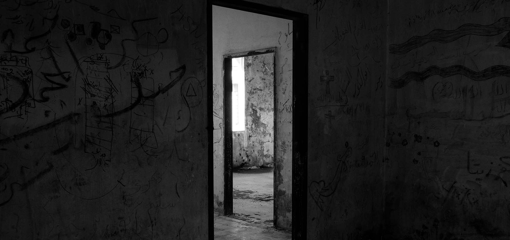 Doorways in a dark abandoned old fort.