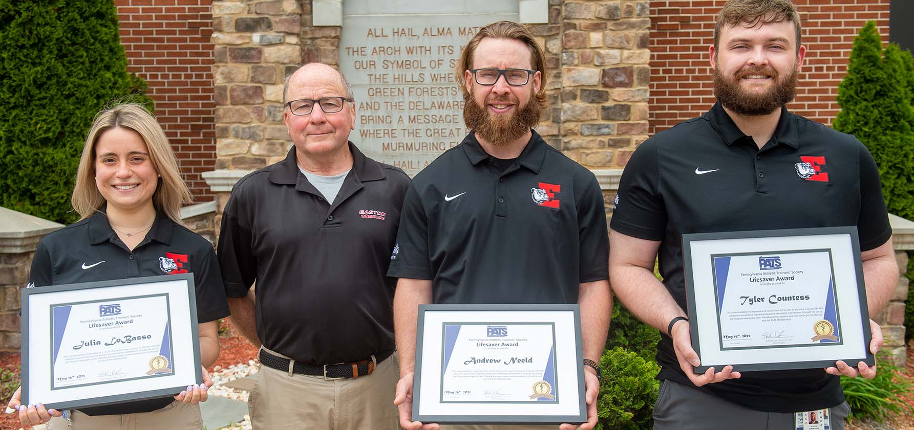 Easton High School's wrestling coach Steve Powell with the athletic trainers who saved his life (left to right): Julia LoBasso, Andrew Neeld, and Tyler Countess '12 G'16..