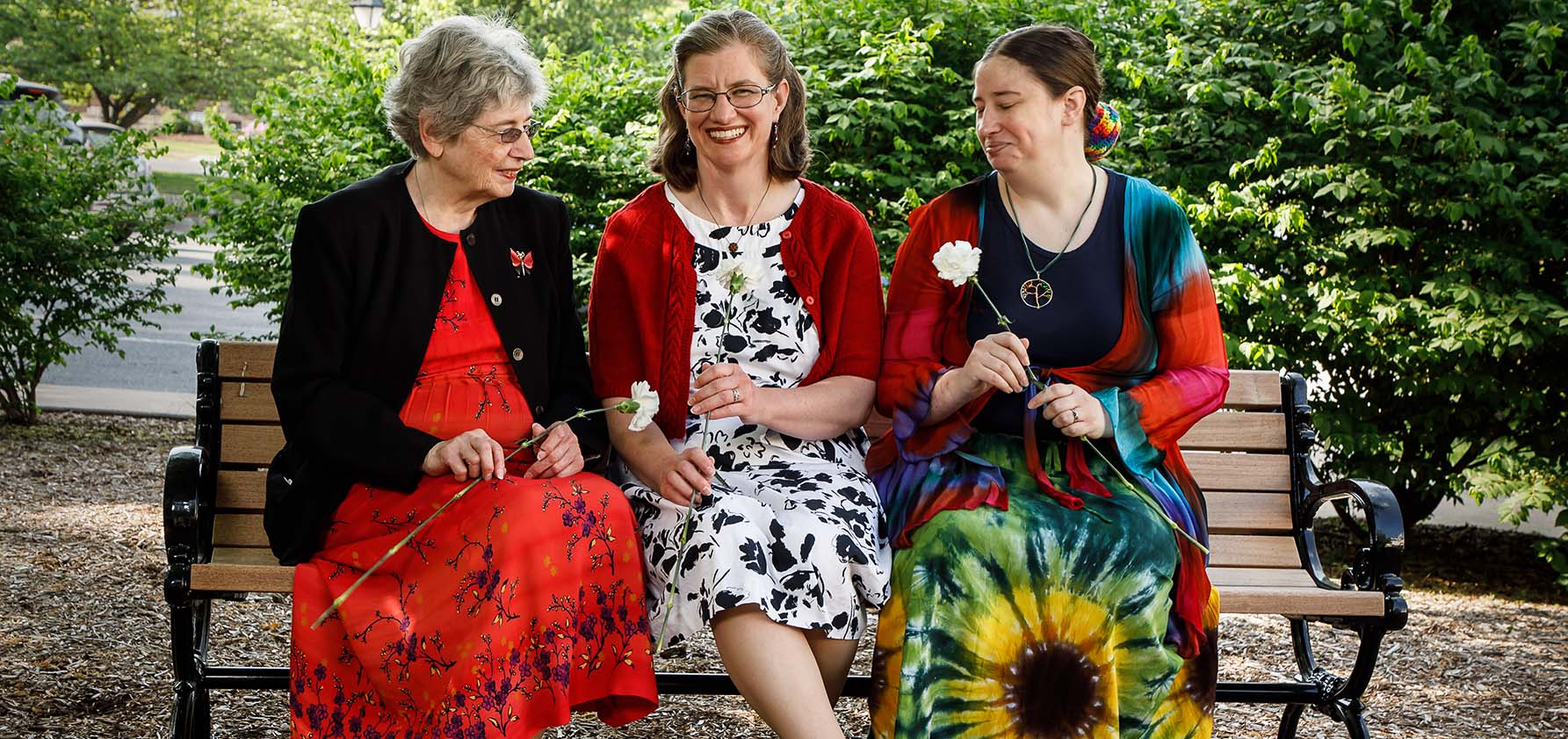 Nena Asquith, Meredith Twardowski, and Shannon Asquith Stahl share memories of Glenn Asquith on the bench they donated in his honor to Moravian Theological Seminary.