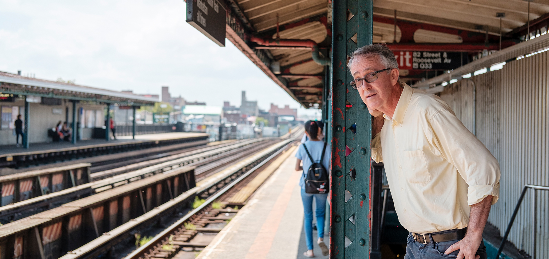 Fred Rooney waits for the train