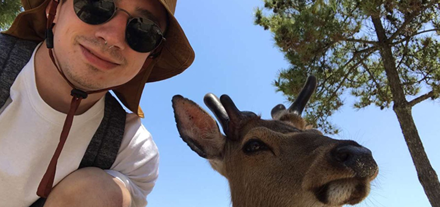 Bailey with a deer in Japan