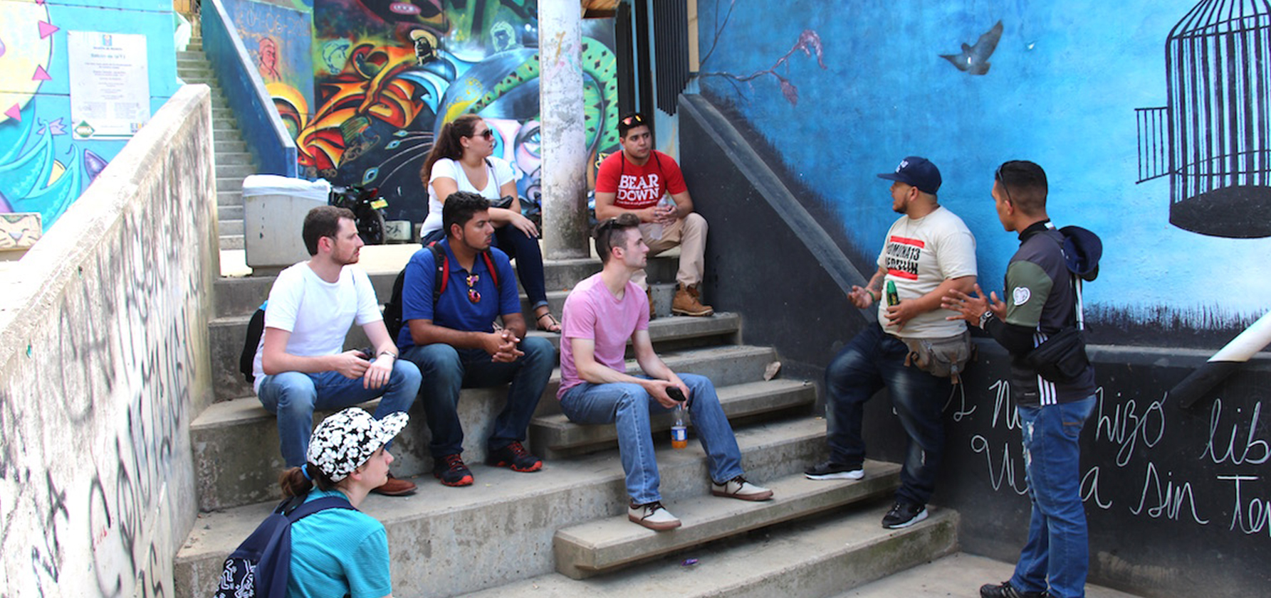 Ciro, a Colombian rapper, tour guide, and neighborhood activist giving the students a tour